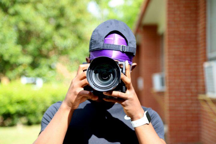 a boy looking through a camera