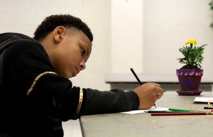 a boy drawing