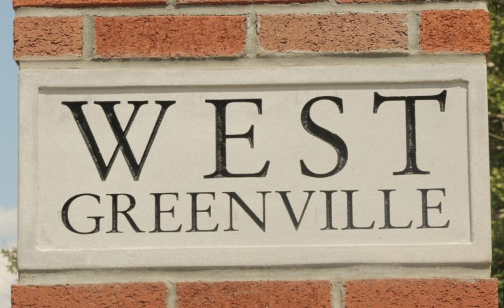 a brick sign that reads West Greenville